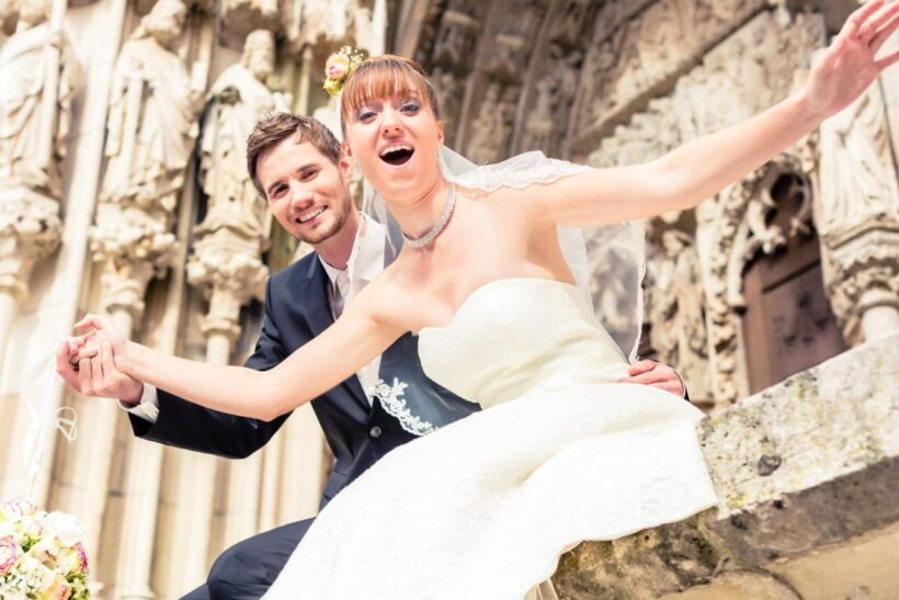 excited-married-in-front-of-church